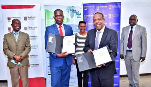 AWWL Managing Director and the Dean Strathmore Business School displaying the signed MoU