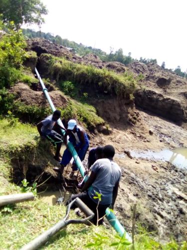 Aduoyo-Kokise Water Supply Project:  Construction of the Rising Main across River Banda Bridge in Asembo Bay in September 2020.